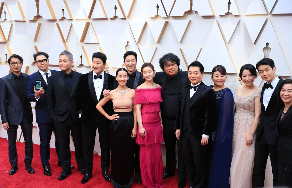 "Director Bong Joon-ho (sixth from the right) and cast and crew members of the film ""Parasite"" at this year's Academy Awards i"