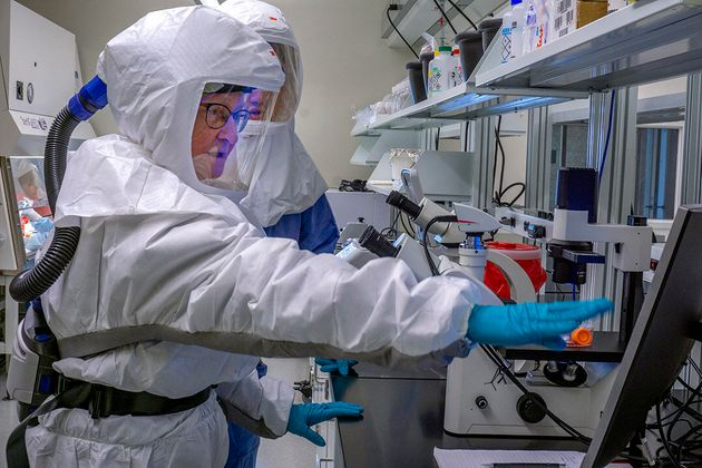 In this publicity photo from the University of Saskatchewan, researchers at VIDO-InterVac work on a COVID-19