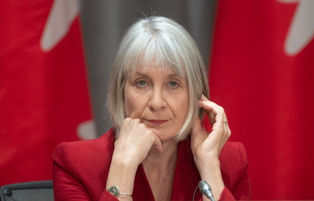 Health Minister Patty Hajdu listens to a translation aid during a news conference in Ottawa on April...