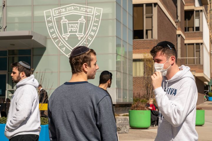 A Yeshiva student wears a face mask on the grounds of the university on March 4, 2020, in New York City after a student at the school tested positive for COVID-19.