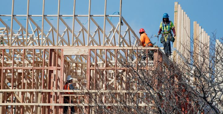 Construction workers continue to toil at a Denver site Thursday as a statewide stay-at-home order takes effect in Colorado to