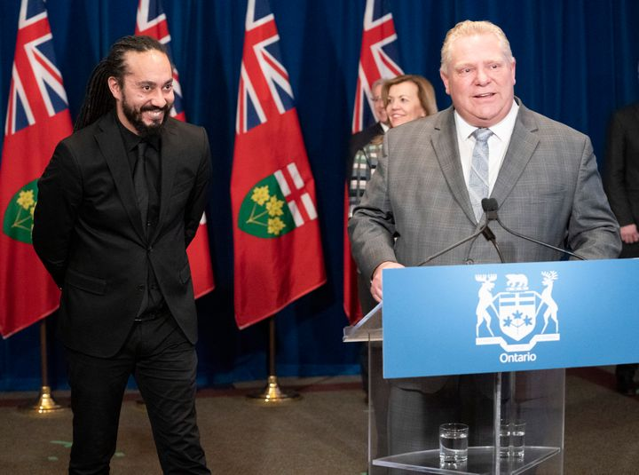 Doug Ford thanks ASL interpreter Christopher Desloges for his work at a daily briefing at Queen's Park on April 1, 2020.