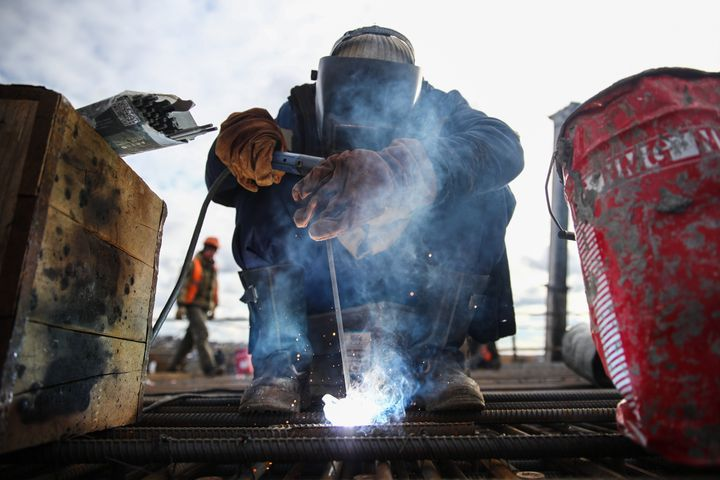 Construction workers are often exposed to fumes that can cause respiratory illness, which could make them more vulnerable to