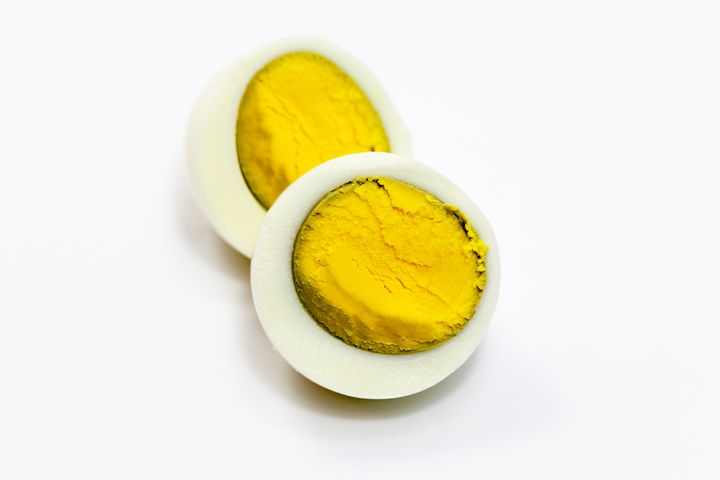 A hard-boiled egg with a dark ring around the yolk due to overcooking.