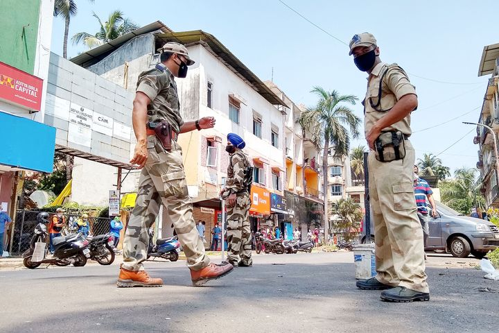 Paramilitary soldiers patrol along a street during a government-imposed nationwide lockdown as a preventive measure against the COVID-19 coronavirus in Goa on March 29, 2020.