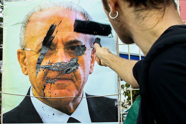 NAPLES, CAMPANIA, ITALY - 2019/11/29: A banner depicting campania region governor Vincenzo De Luca labeled...