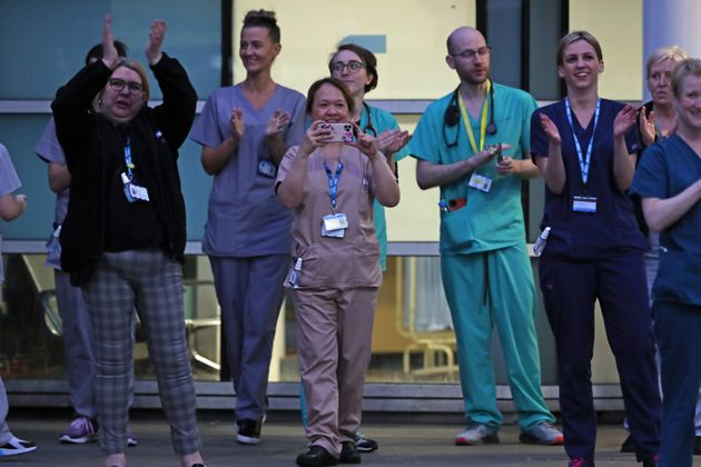 Staff from the Royal Liverpool University Hospital join in a national applause during Thursday's nationwide...