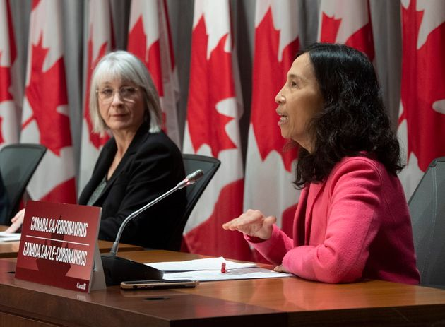 Minister of Health Patty Hajdu looks on as Chief Public Health Officer Theresa Tam responds to a question...