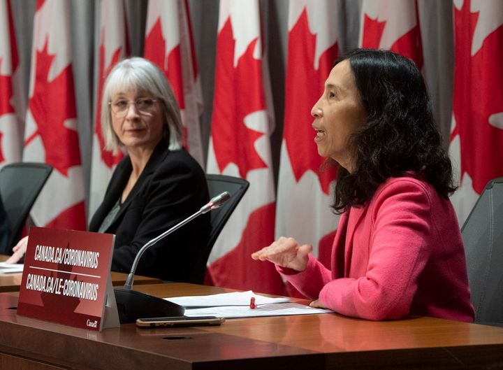 Minister of Health Patty Hajdu looks on as Chief Public Health Officer Theresa Tam responds to a question during a news conference in Ottawa on April 2, 2020.