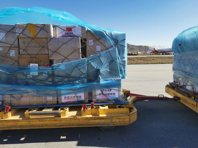 China-donated medical supplies are unloaded in Kabul, Afghansitan, April 2,
