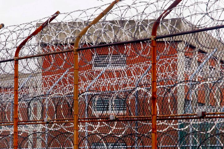 In this March 16, 2011, file photo, a security fence surrounds inmate housing on the Rikers Island correctional facility in N