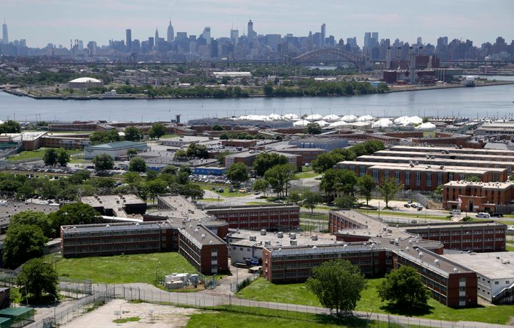 This June 20, 2014, file photo shows the Rikers Island jail complex with the Manhattan skyline in the background.