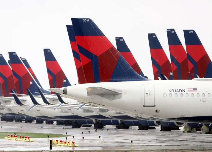 Planes belonging to Delta Air Lines sit idle at Kansas City International Airport on Friday.