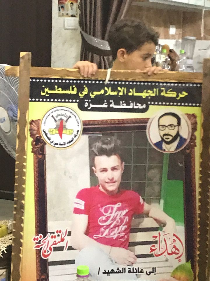 In Gaza, a poster for a child killed by an Israeli air strike bears the name of one of the militant groups that dominate the