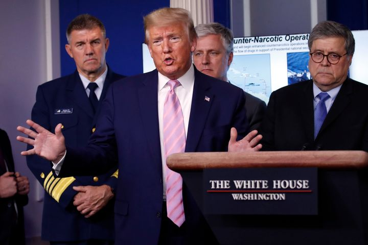 President Donald Trump speaks about the coronavirus on April 1, 2020, as (left to right) Adm. Karl Leo Schultz, commandant of