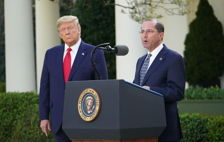 Health and Human Services Secretary Alex Azar with President Donald Trump at a March 30 coronavirus task force briefing in th