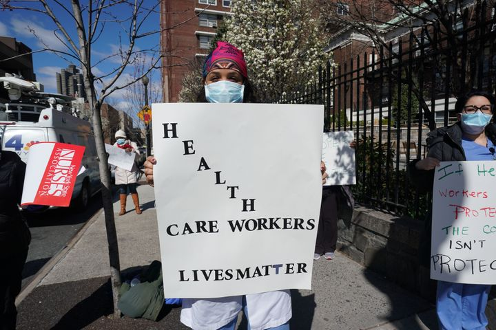 Members of the medical staff listen Wednesday as Montefiore Medical Center nurses call for N95 masks and other critical prote