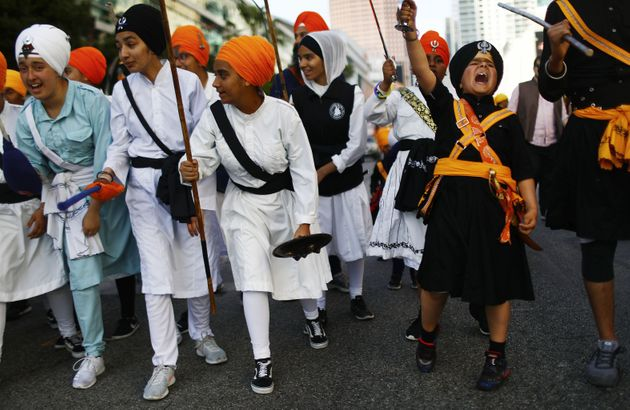 Young Sikhs practice traditional Indian martial arts during an annual parade marking Vaisakhi on April...