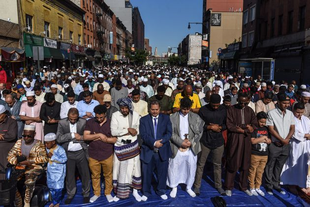 People pray outside a mosque to mark the end of the Muslim holy month of Ramadan in Brooklyn, New York,...
