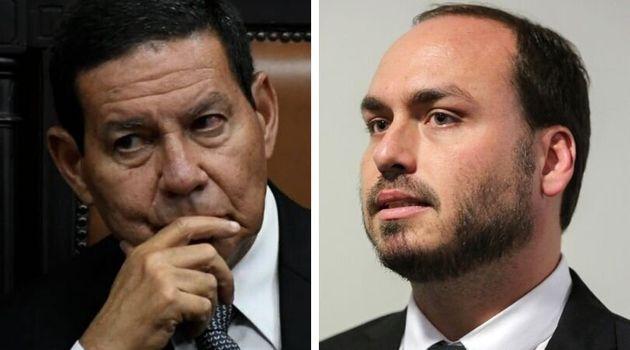 O vice-presidente Hamilton Mourão (à esq.) e o vereador Carlos Bolsonaro (à
