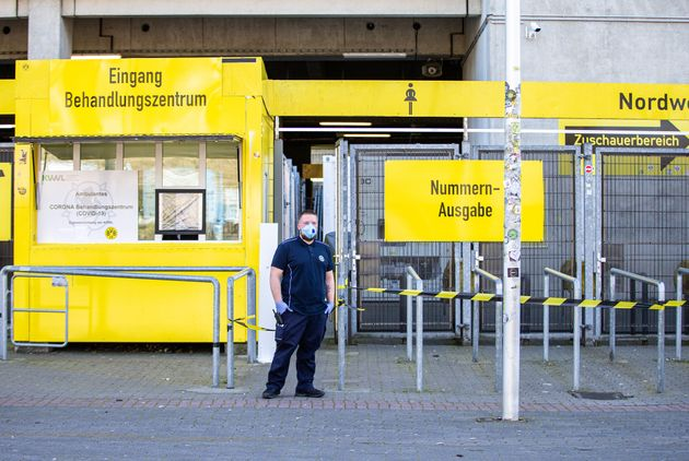 DORTMUND, April 4, 2020: A security member wearing a protective mask stands guard outside the COVID-19...