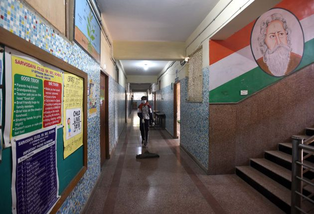 NEW DELHI, INDIA - MARCH 30: A worker cleans the gallery at Sarvodaya Co-Ed Senior Secondary School IP...