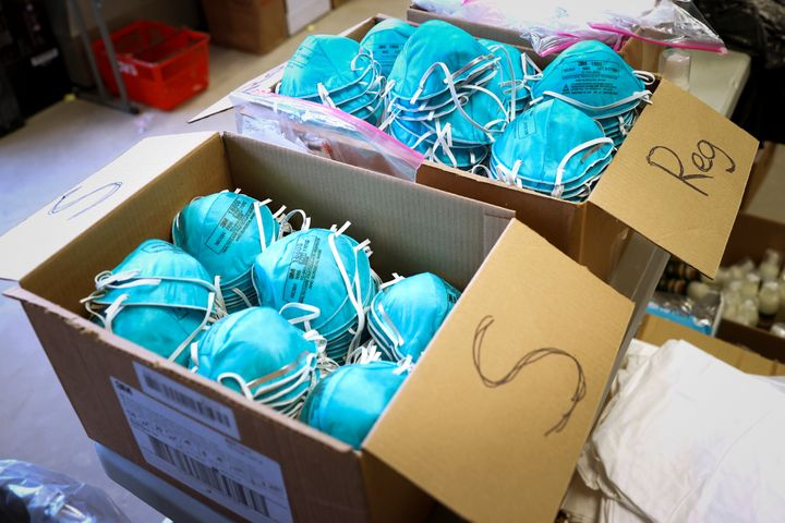Boxes of N95 protective masks for use by medical field personnel are seen at a New York State emergency operations incident c