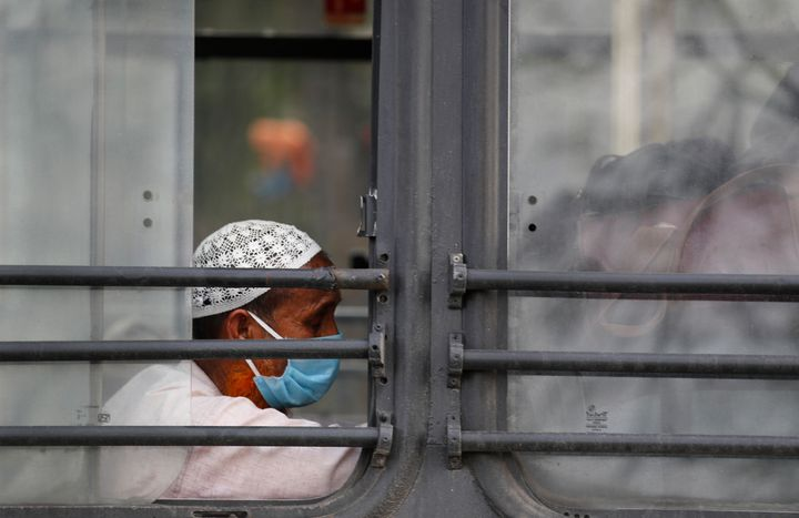 Muslim pilgrims wait in a bus that will take them to a quarantine facility, amid concerns over the spread of the coronavirus