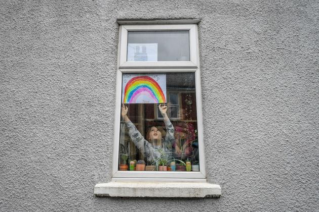 The Queen referenced the drawings of rainbows being placed in household windows to keep children's...