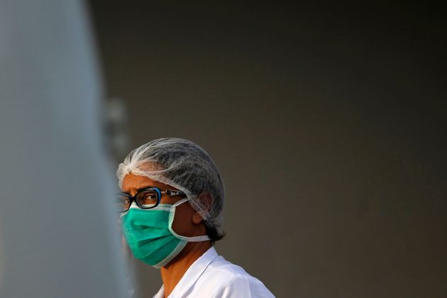 A nurse wears a protective face mask at the North Wing Regional Hospital (HRAN), after reports of the...