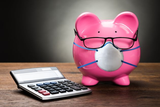 Pink Piggybank With Calculator On Wooden