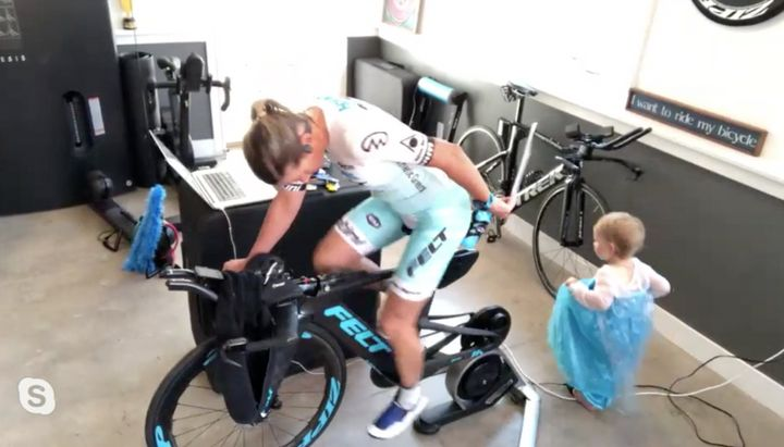 Mirinda Carfrae's toddler amused herself while mom cycled against international champs in the Ironman VR Pro Challenge race.
