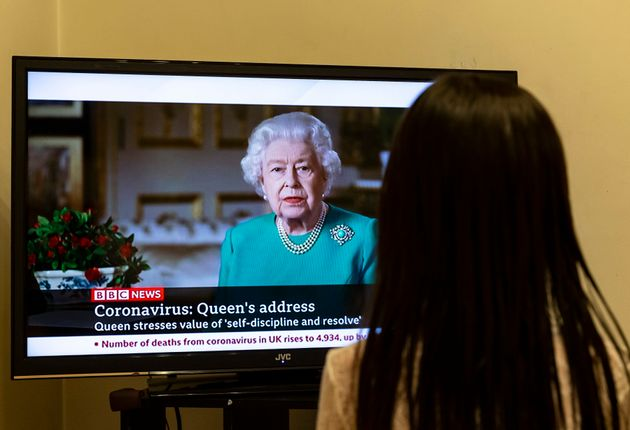 LONDON, April 5, 2020 . A girl watches British Queen Elizabeth II's address on TV in London, Britain,...