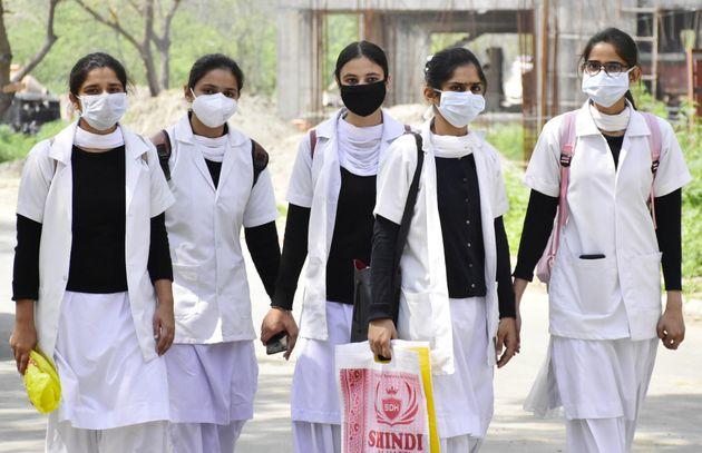 AMRITSAR, INDIA - MARCH 16: Nursing students wearing protective face masks as precaution against coronavirus,...