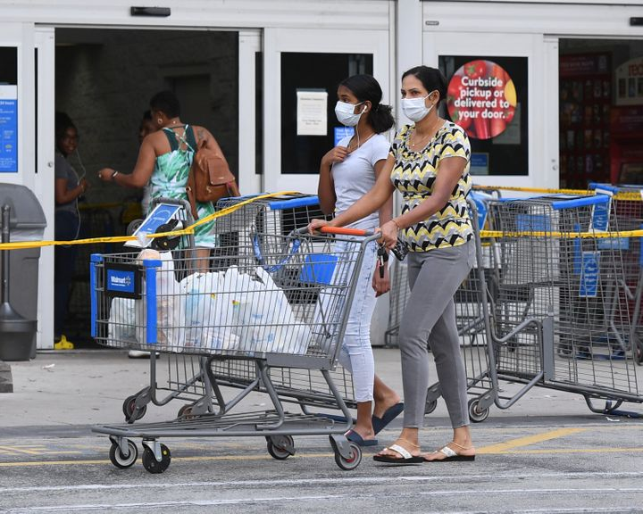 Shoppers at a Walmart in Coconut Creek, Florida, on Saturday as the chain's stores began limiting the number of customers ins
