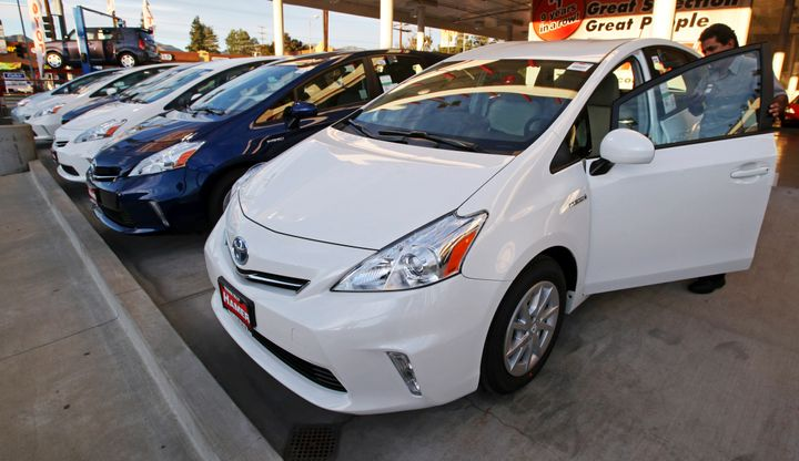 An employee parks a Toyota gas-electric hybrid automobile in a row of similar cars at a dealership in Los Angeles Thursday, J