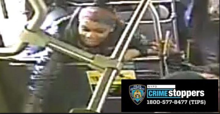 The unidentified female shown here struck the victim with an umbrella, according to police. The NYPD has asked anyone with information regarding the suspect's identity to call 1-800-577-TIPS (8477).