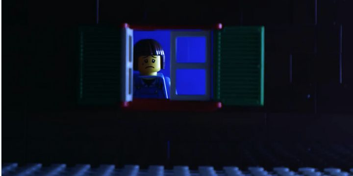 A sad LEGO boy isolated from his plastic playmates during the COVID-19 pandemic.