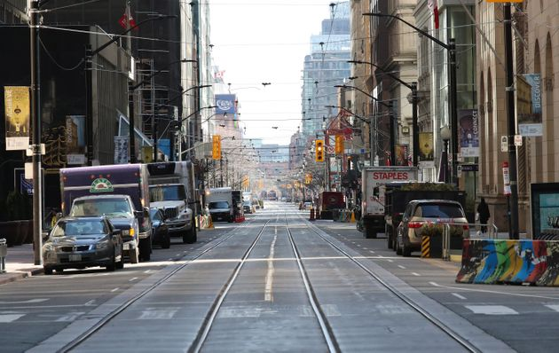 TORONTO, ON- APRIL 6 - Traffic was at a minimum looking East on King from Bay as Toronto encourages people...