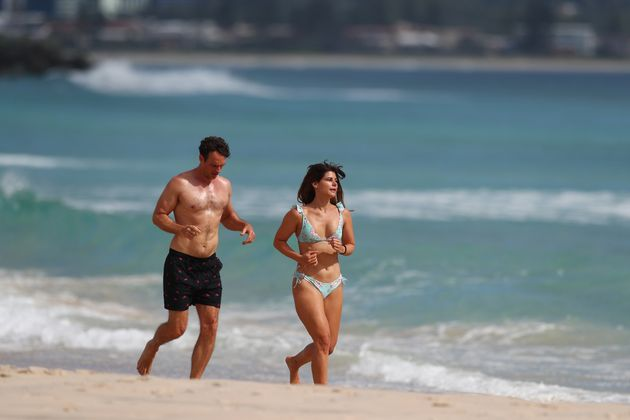 People run along Coolangatta beach on April 07, 2020 in Gold Coast, Australia. A number of major Gold Coast beaches will close from midnight on Tuesday over COVID-19 concerns.