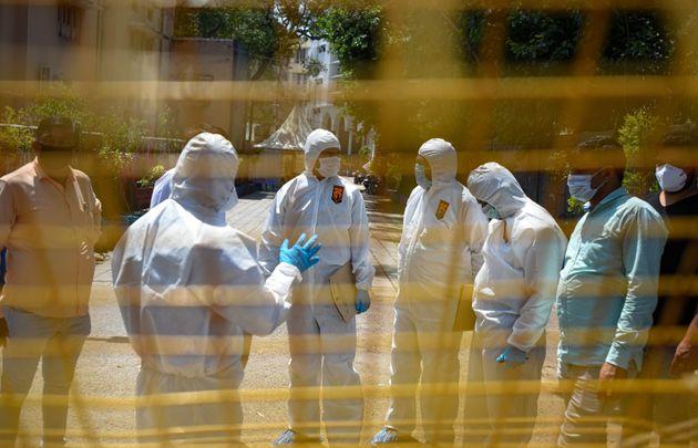 A Delhi Forensic Science Laboratory team during an investigation at the Markaz Banglewali Masjid in Nizamuddin,...