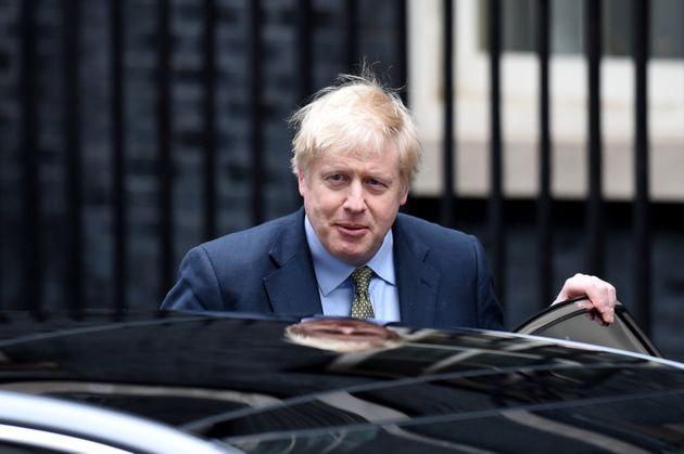 British Prime Minister Boris Johnson is seen here leaving his official residence on London's Downing...