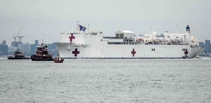 The Navy hospital ship USNS Comfort sails into New York on March 30. The ship initially planned to help treat non-coronavirus