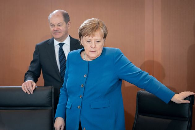 11 March 2020, Berlin: Olaf Scholz (SPD), Federal Minister of Finance, and Chancellor Angela Merkel (CDU)...