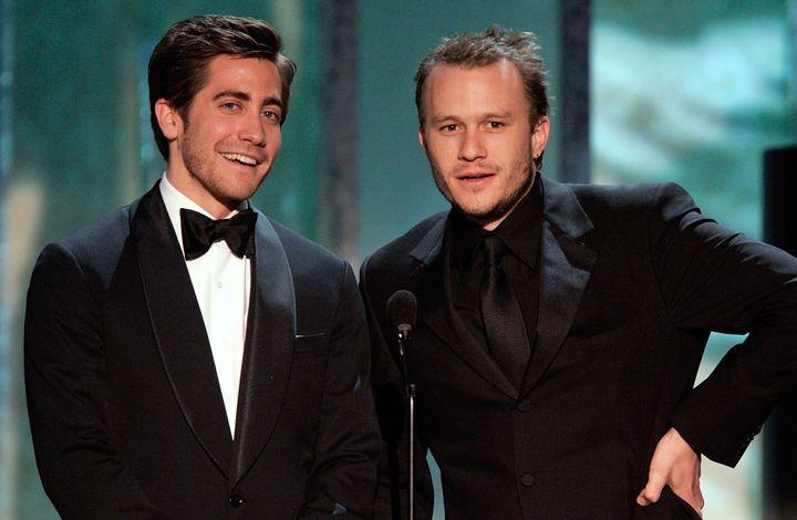 Jake Gyllenhaal and Heath Ledger speak onstage during 2006 Screen Actors Guild Awards.