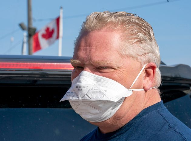 Ontario Premier Doug Ford leaves after picking up a load of ASTM Level 3 masks made by The Woodbridge...
