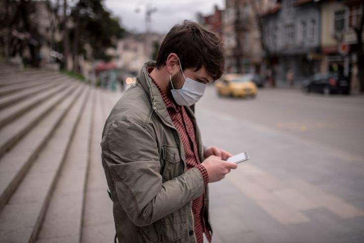 Social distancing and other preventive measures remain important even when a person doesn't appear to be sick.