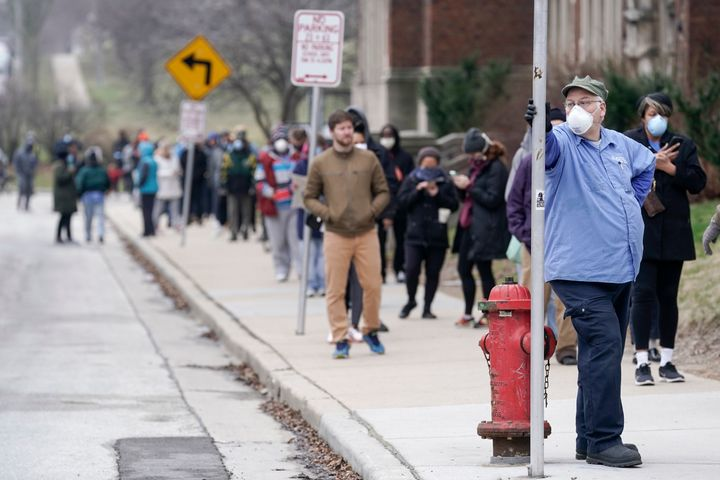 Voters masked against coronavirus line up at Riverside High School for Wisconsin's primary election, April 7 in Milwaukee.