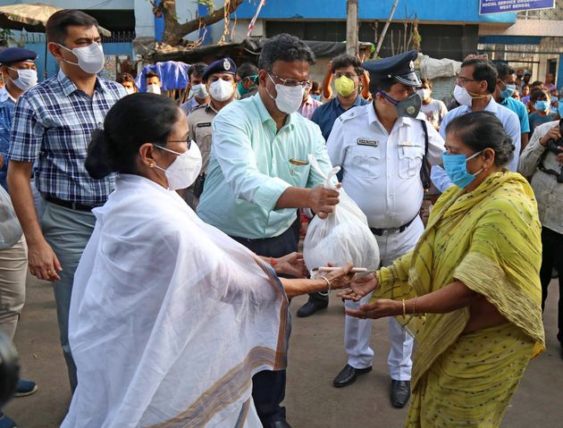 West Bengal Chief Minister Mamata Banerjee distributes food and essential commodities to the homeless...