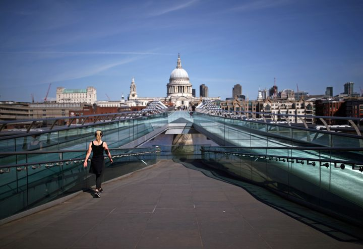 A jogger on the Millennium Bridge in London, as the UK continues in lockdown to help curb the spread of the coronavirus.